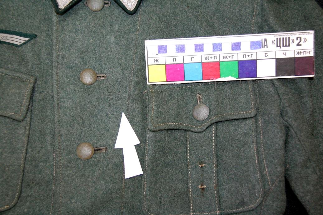 Фрагмент левой полочки кителя  после реставрации